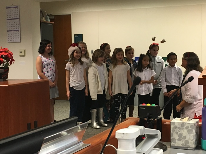 Windsor Creek Students bring holiday cheer to the Board Meeting