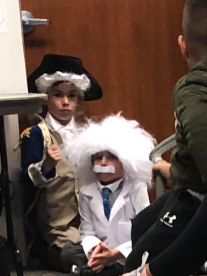 George Washington and Albert Einstein wait patiently to present to the School Board