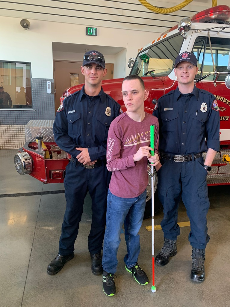 NCC Student with two fire fighters