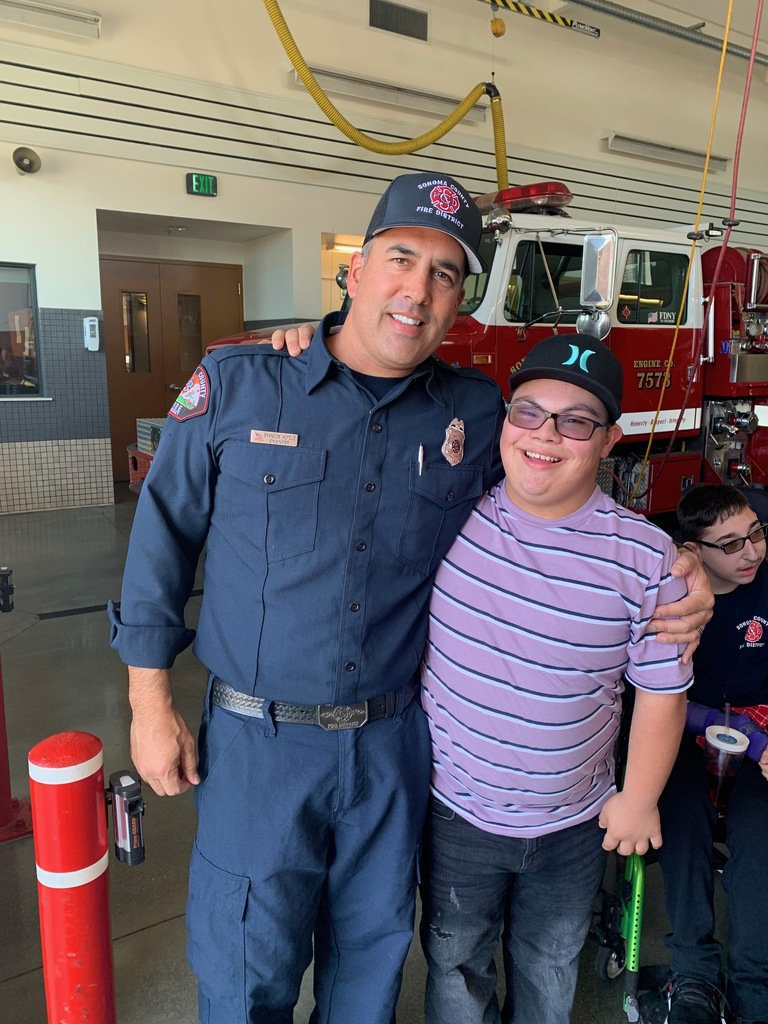 Student thanking fire fighter